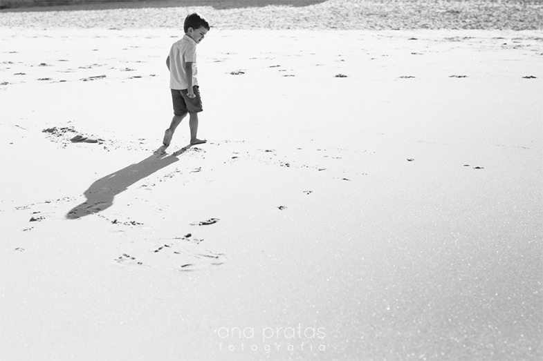 kid walking in the sand