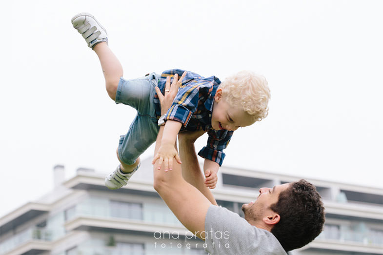 dad throws son in the air