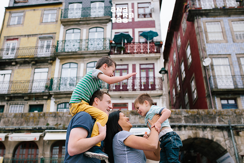 Family with two kids having fun in Ribeira do Porto
