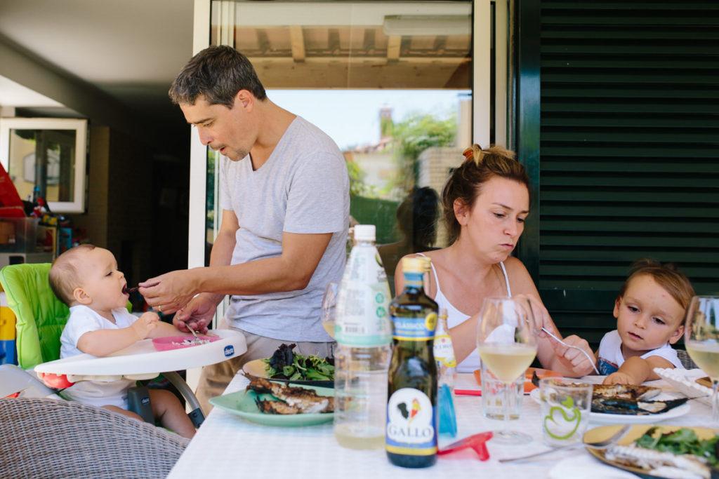 family having lunch in their backyard