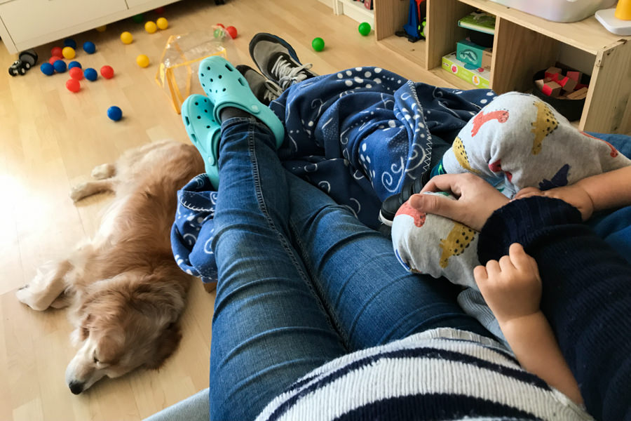 family relaxing at the living room with dog